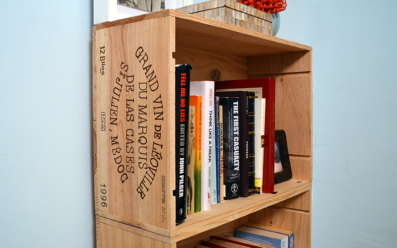 The wine crate detail adds a little je ne sais quoi to an otherwise mundane bookshelf